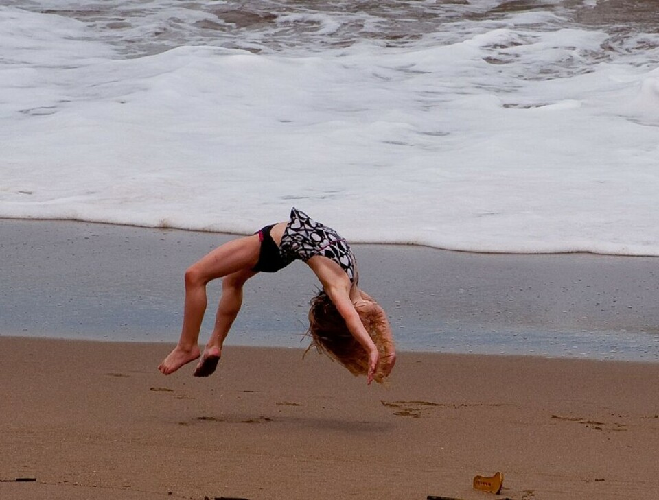 slider-girl-back-flip-beach