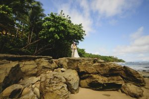 bride-groom-beach-rocks-kissing