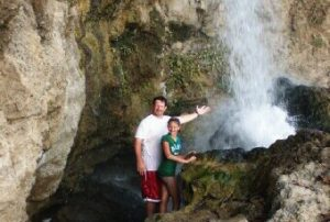 family-at-waterfall